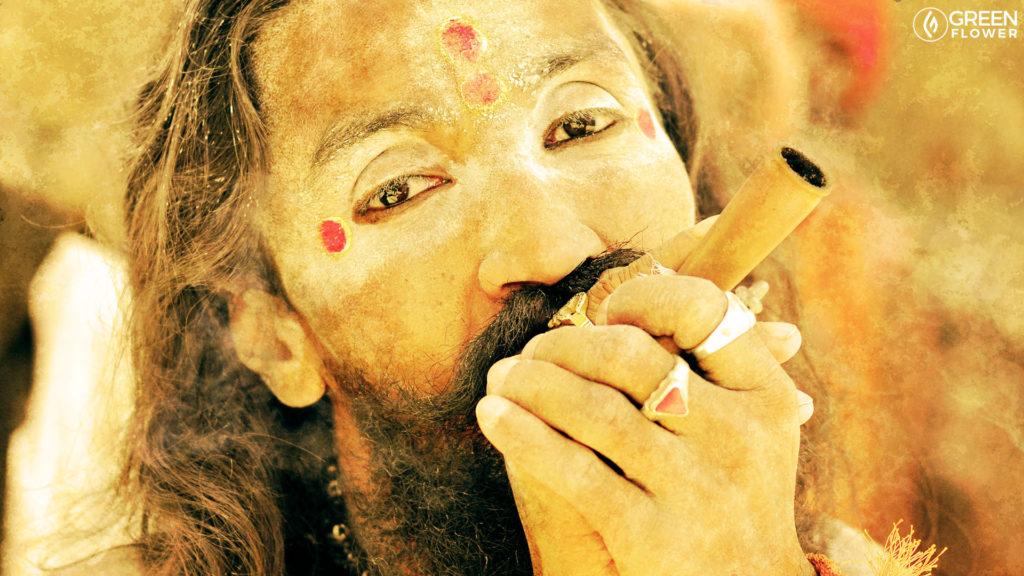 man smoking a chillum in ritual