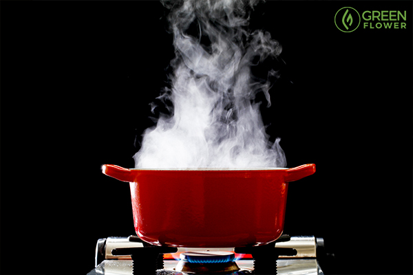 steaming pot over flame