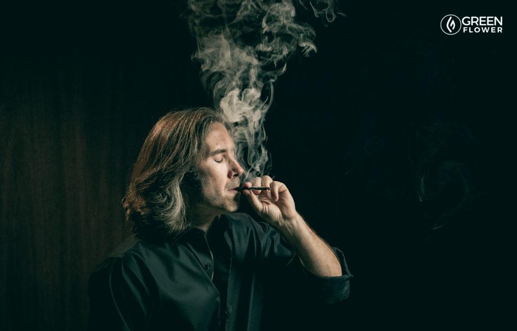 man smoking joint in black shirt